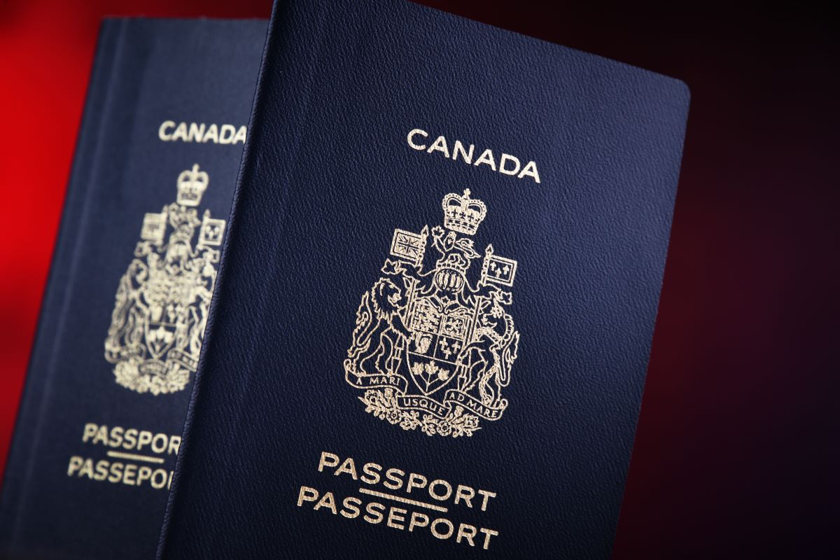 blue Canadian passports on red background