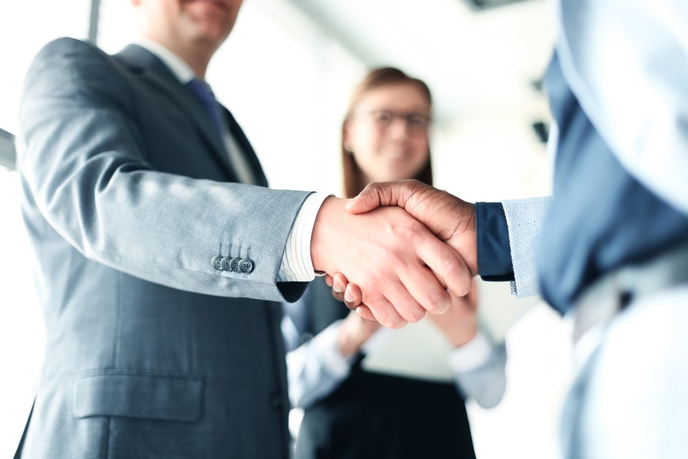 RCIC shaking hands with client after applying for Canadian visa