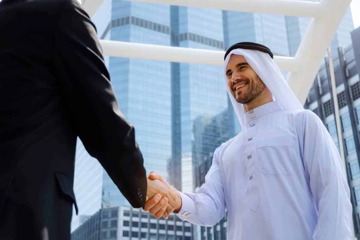 Islamic man shaking hands with business man | immigrate to Canada