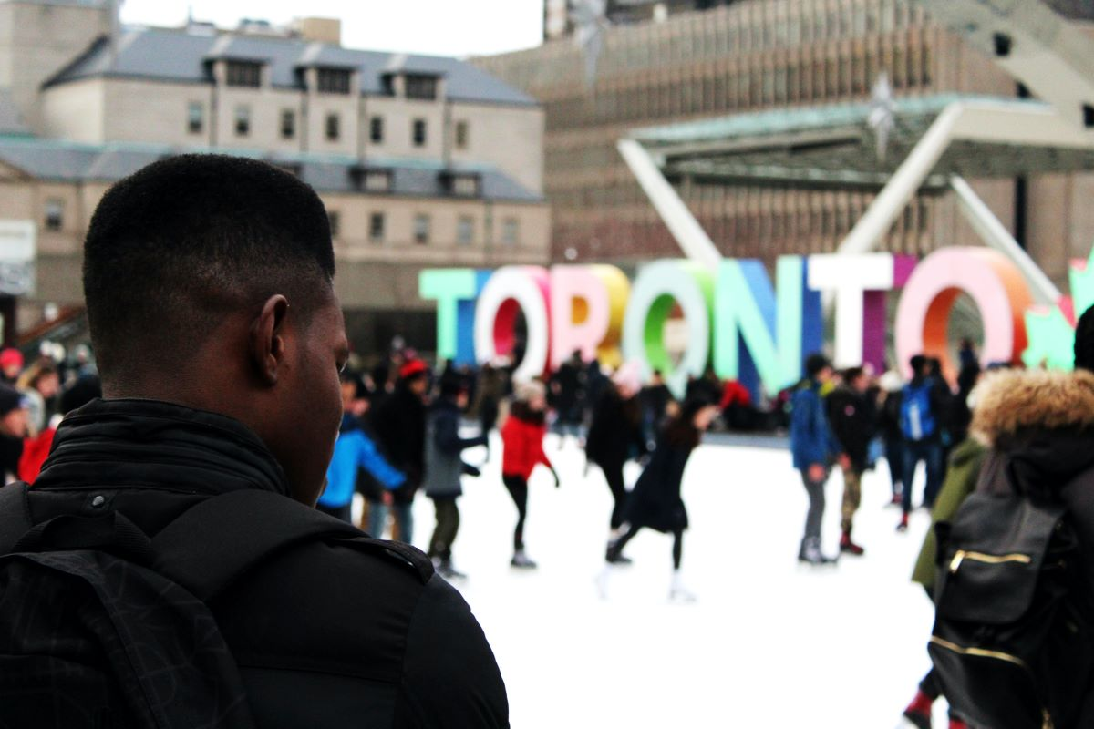 People ice skating on an ice rink in Toronto, Canada