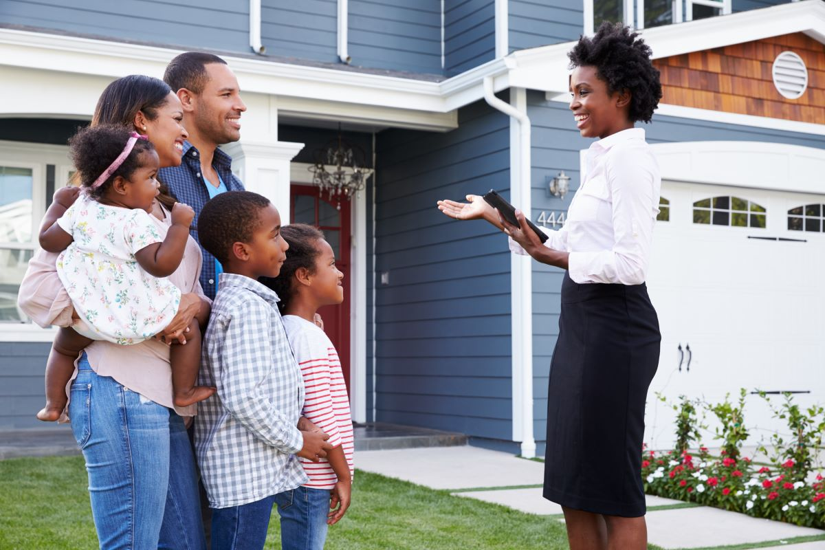 Real estate agent showing a house to potential buyers