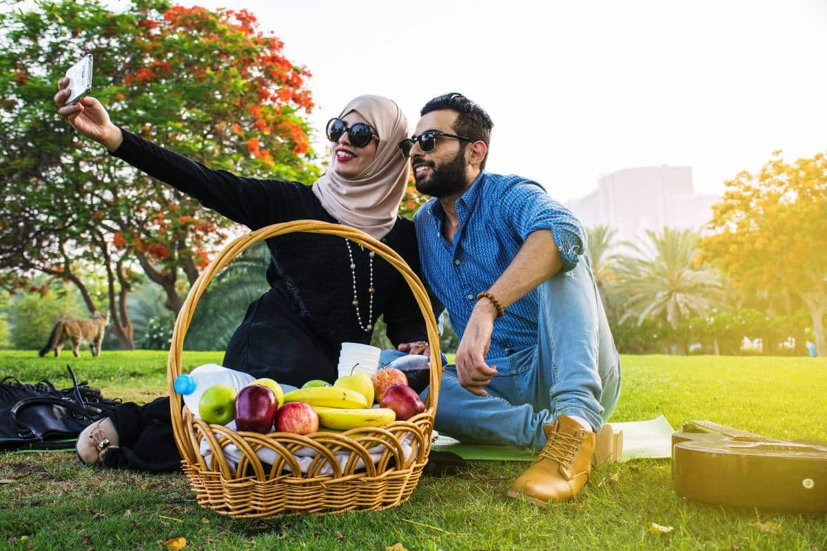 Arab couple taking selfie in park | immigrate to Canada from Lebanon