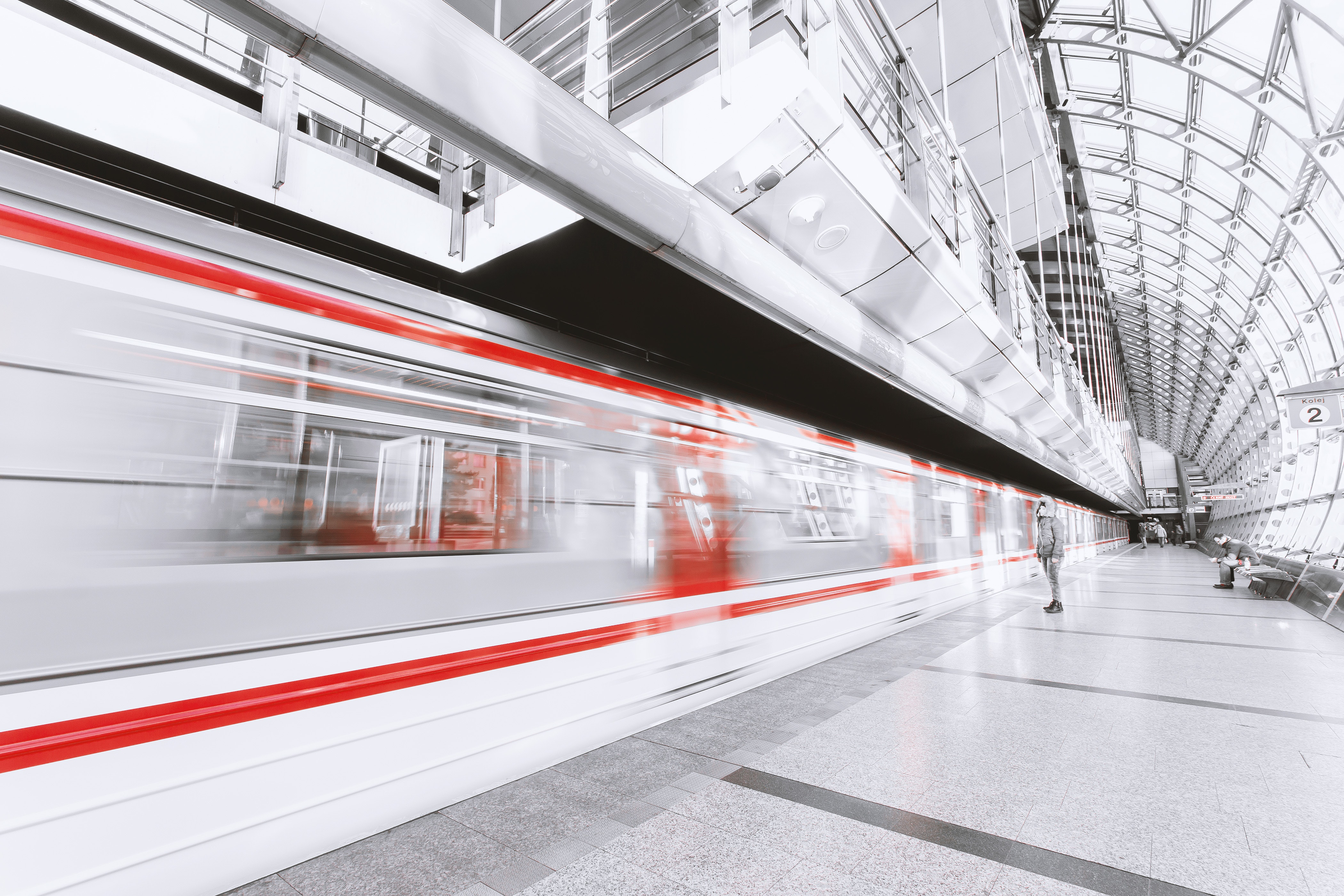 red and white blurred commuter