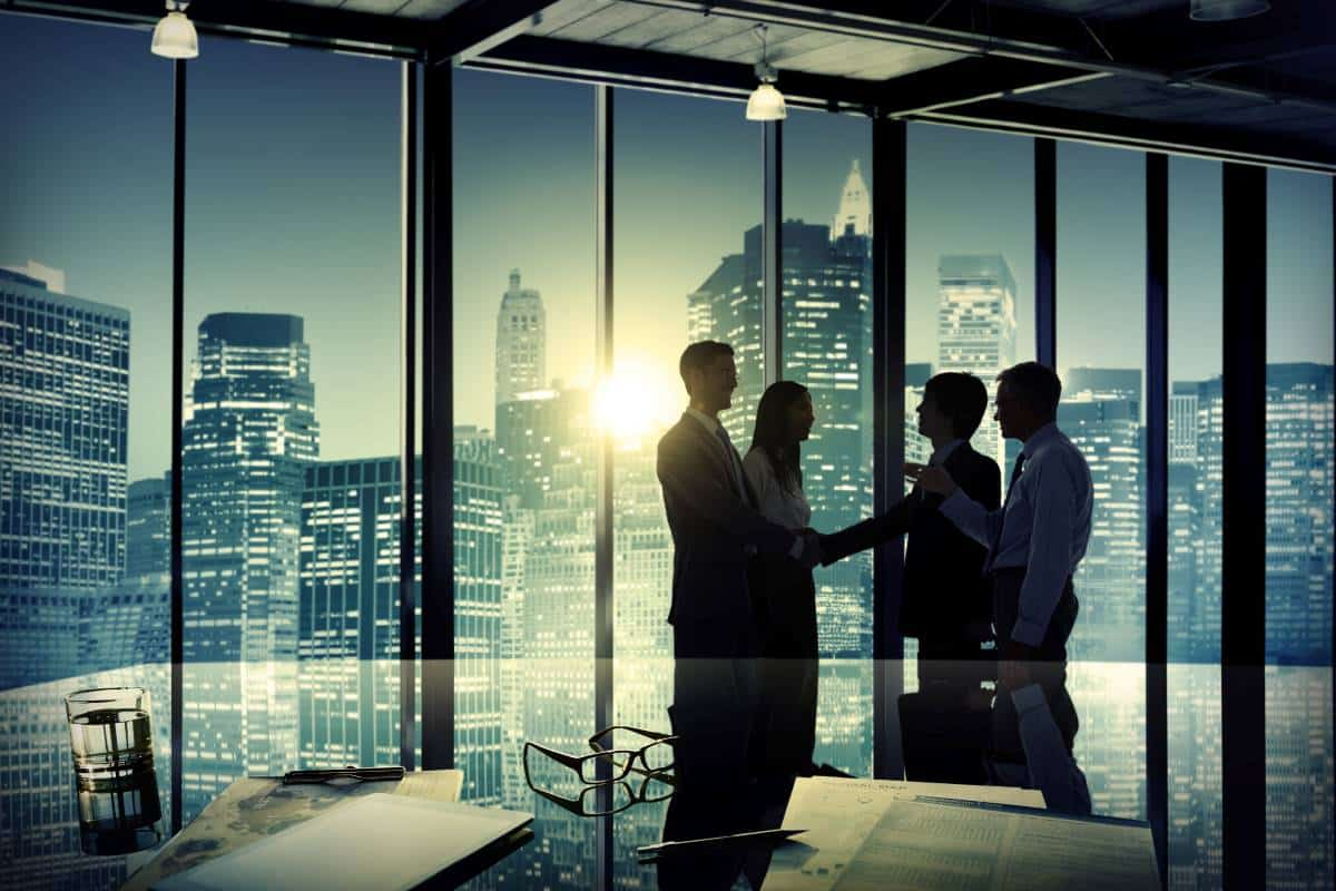 business consultants shaking hands with clients in office | apply for visa to Canada
