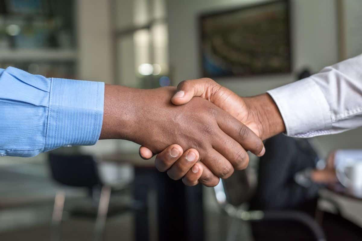 Two men shaking hands | Trust