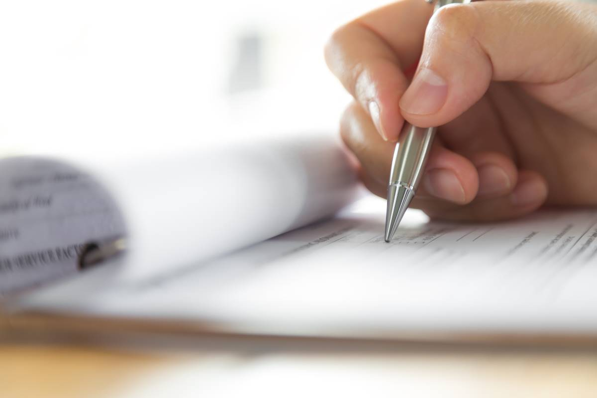 hand writing with pen completing application form | apply for Canada visa