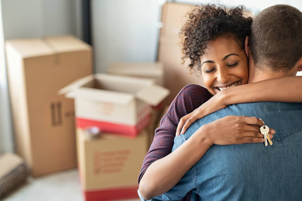happy woman hugging her husband after move to Canada