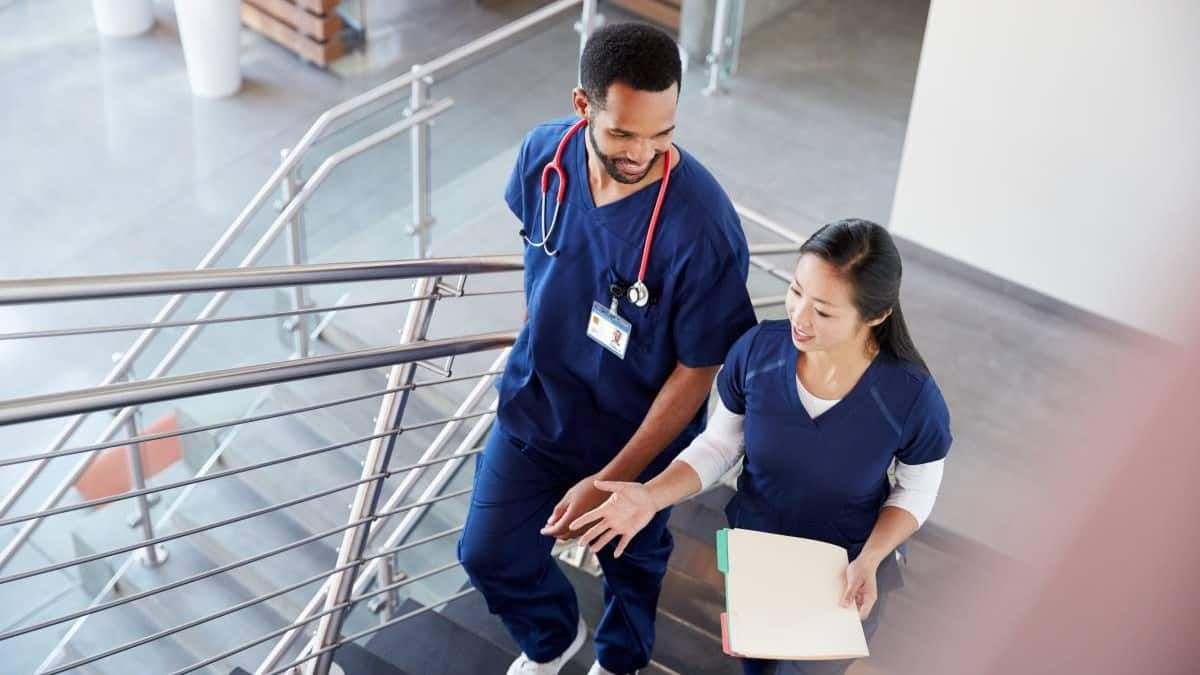 nurse and doctor walking up stairs in hospital | tops jobs in Nova Scotia Canada