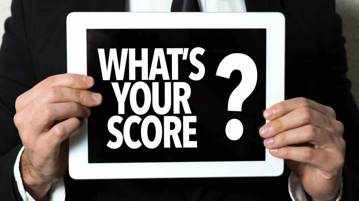 man-in-suit-holding-what-s-your-score-board | Canada immigration points system