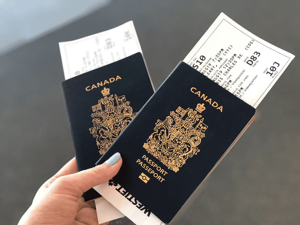 Canadian passport with airline tickets