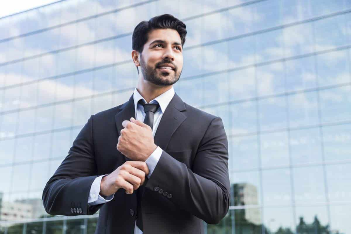 smiling Arab businessman wearing suit | immigrate to Canada from Lebanon