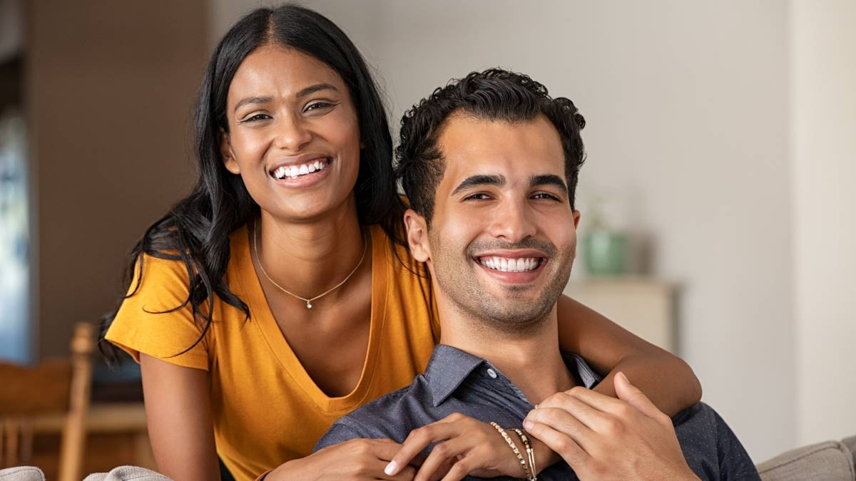 smiling-happy-Indian-couple-holding-each other | move to Canada