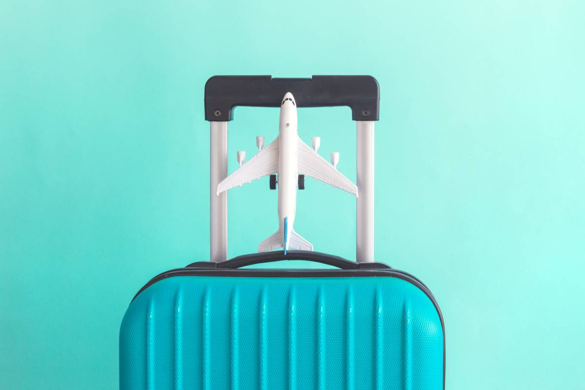 suitcase and model airplane | move to Canada