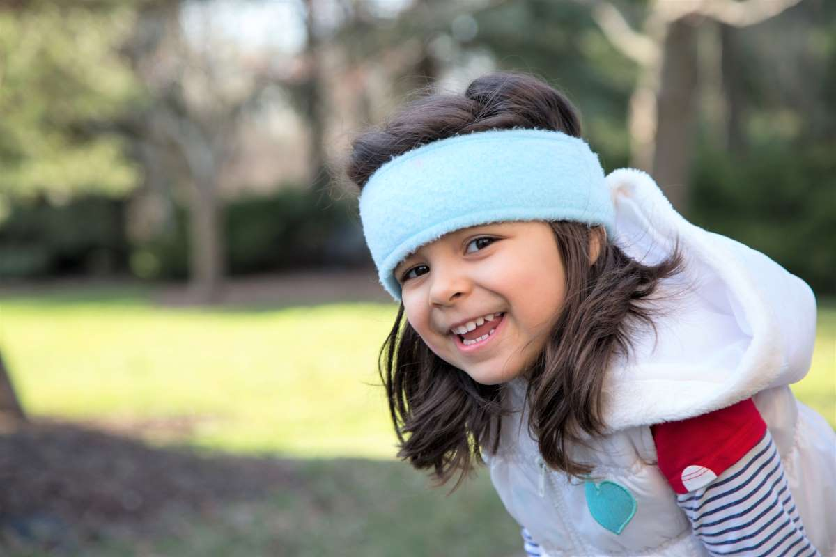 smiling young Lebanese girl in park | immigrate to Canada from Lebanon